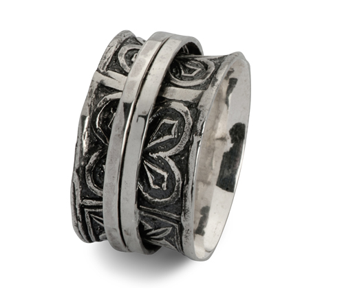 Sterling Silver Spinner ring with an oxidized finish and a flower pattern.